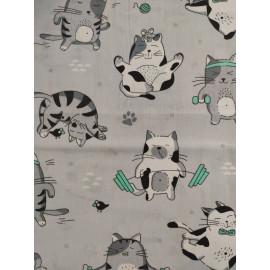 Tissu chats sportifs menthe - en coton certifié - vendu par 10cm