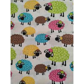 Tissu moutons colorés - en coton certifié - vendu par 10cm